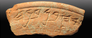 A ceramic bowl shard with a 2,700-year-old inscription. City of David