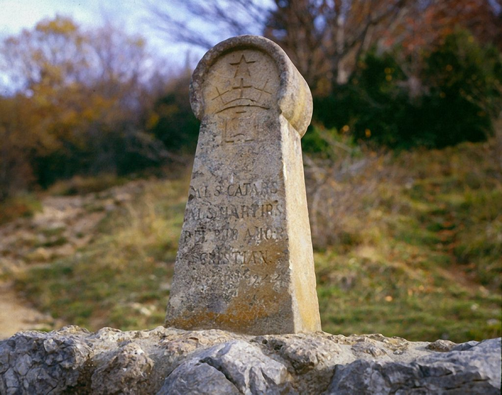 This image has an empty alt attribute; its file name is 126S335Stone-markeratthe-foot-of-Montsegur-commemorating-the-massacre-of-the-Albigenses-1024x805.jpg